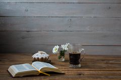 A coffee cupcake flowers and open book on a wooden background. Coffee cupcake flowers and open book on a wooden background stock photo