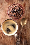 Coffee and cupcake in rustic style on wooden table Stock Photography