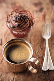 Coffee and cupcake in rustic style on wooden table Stock Photos