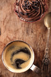 Coffee and cupcake in rustic style on wooden table Royalty Free Stock Image