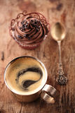 Coffee and cupcake in rustic style on wooden table Royalty Free Stock Photo