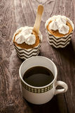 Coffee with cupcakes. Black Coffee with cupcakes  on wooden table Stock Photo