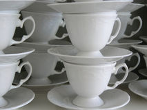 Coffee cups. Stack of white coffee cups royalty free stock photography