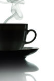Coffee in cups. Black silhouette of a cup of coffee on a white background Royalty Free Stock Photos