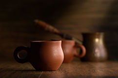 Coffee in cups. Two cups of coffee and coffee pot on a dark background Royalty Free Stock Image