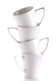 Coffee cups. A tower of white coffee cups isolated on white background Stock Images