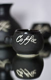 Coffee cups. Ceramic coffee cups reflection in the mirror Stock Photography