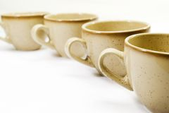 Coffee cups. Perspective of brown porcelain coffee cups Stock Photo