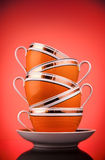Coffee cups. Stack of coffee cups on red background Stock Photography