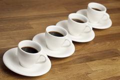 Coffee cups. Row of white coffee cups Stock Photos