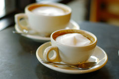 Coffee cups. Cappuccinos in a cafe stock image