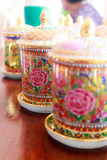 Coffee cups with antique Thai pattern. On wooden table Stock Images