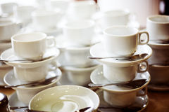 Coffee cups in a bar Stock Images
