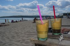Coffee cups on the beach. Of Varna in the heat of the summer Stock Photo