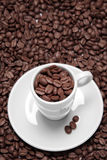 Coffee Cups and Beans Stock Images
