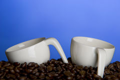 Coffee cups and beans Royalty Free Stock Image