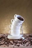 Coffee cups and beans on old table Royalty Free Stock Photo