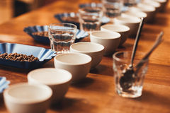 Coffee cups and beans on table ready for a tasting Stock Photo