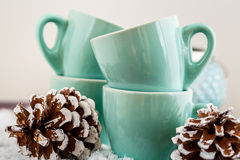 Coffee cups and Christmas decorations Royalty Free Stock Image