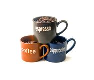 Coffee cups with coffee beans. Coffee espresso cappuccino cups with coffee beans isolated on white background Royalty Free Stock Photography