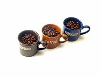 Coffee cups with coffee beans. Coffee espresso cappuccino cups with coffee beans isolated on white background Stock Images