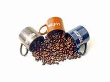 Coffee cups with coffee beans. Coffee espresso cappuccino cups with coffee beans isolated on white background Royalty Free Stock Photos