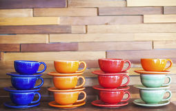 Coffee cups. Colorful coffee cups on brick wall background Stock Image