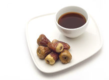 A coffee cups and dates. Stock Photography