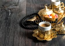 Coffee cups delight golden decorations rosary Ramadan kareem. Coffee cups, delight, golden decorations and rosary. Ramadan kareem Stock Image