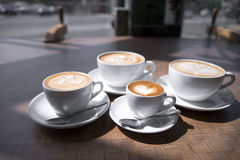 Coffee cups of different size with pattern on surface Royalty Free Stock Image