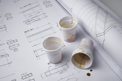 Coffee cups on draft Stock Images
