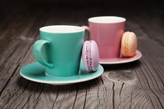 Coffee cups with french macaroons Stock Photo