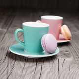 Coffee cups with french macaroons on table Royalty Free Stock Photo