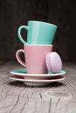 Coffee cups with french macaroons on wooden table Stock Photo