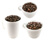 Coffee cups full of coffee beans. Three different coffee cups full of coffee beans on white background royalty free stock images