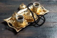 Coffee cups golden decoration rosary Ramadan kareem Stock Photo