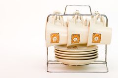 Coffee cups hanging Stock Photo