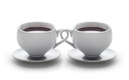 Coffee cups intertwined Royalty Free Stock Images