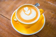 Coffee cups with latte art in cafe royalty free stock images