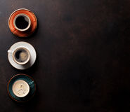 Coffee cups on old kitchen table Royalty Free Stock Images