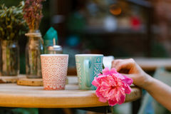 Coffee cups in an outdoor cafe Stock Photo