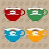 Coffee cups over coffee beans background Royalty Free Stock Photography