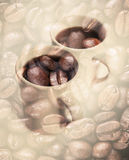 Coffee cups over dark rusted coffee beans Royalty Free Stock Photo