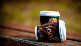 Coffee cups. Paper cups of coffee on the bench Royalty Free Stock Photos