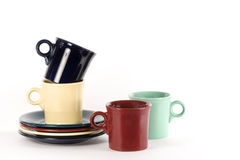 Coffee Cups & Plates. Colorful vintage fiestaware coffee cups and plates on white background Royalty Free Stock Image