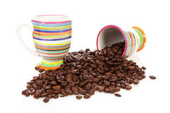 Coffee cups and roasted beans Stock Images