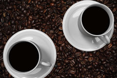 Coffee cups and roasted coffee beans Stock Image