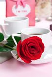 Coffee cups and rose Royalty Free Stock Images