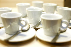 Coffee cups and saucers at an event Stock Photos
