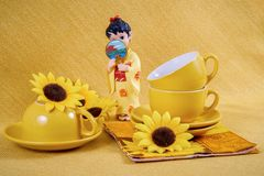 Coffee cups and saucers  and figurine geisha Stock Photo